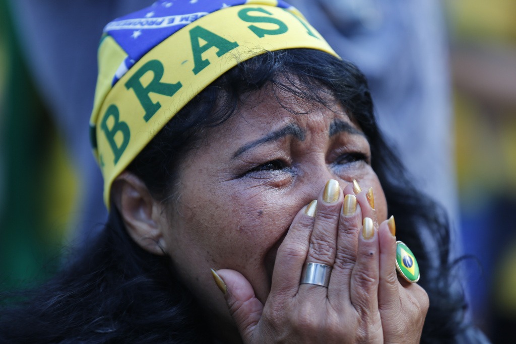 A fan of Brazil reacts as she watches as the Netherlands scores a second goal against Brazil, during the match for the third place finish of the World Cup, at the FIFA Fan Fest in Sao Paulo, Brazil, Saturday, July 12, 2014.