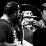 Beatboxer and musician Shodekeh (left) performs with members of the Alash Ensemble