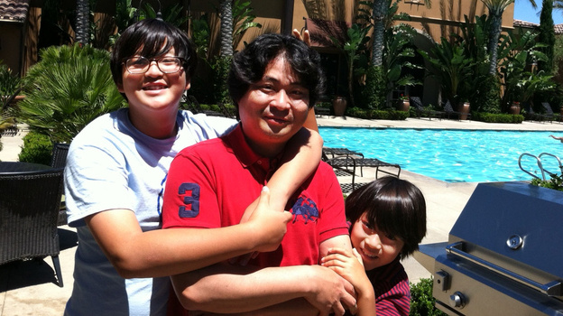 Hyungsoo Kim brought his sons Woosuk (left) and Whoohyun to California from Korea so the boys could get an American public-school education. In