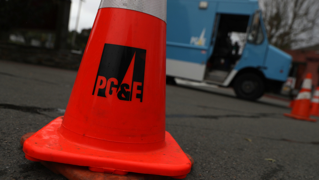 A traffic cone sits next to a Pacific Gas & Electric truck earlier this month in Fairfax, Calif.
