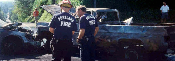 Firefighters respond to a fiery collision involving a side-saddle pickup in Portland, Ore., in August 2003. The truck ran a stop sign and was struck by the car, puncturing the truck's fuel tank and setting off a fireball and loud explosions. A 59-year-old passenger in the car suffered third-degree burns but survived.