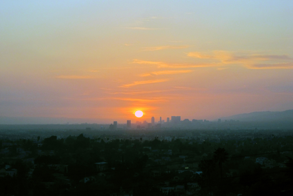 A haze of smog adds to the sunset as seen from downtown Los Angeles.