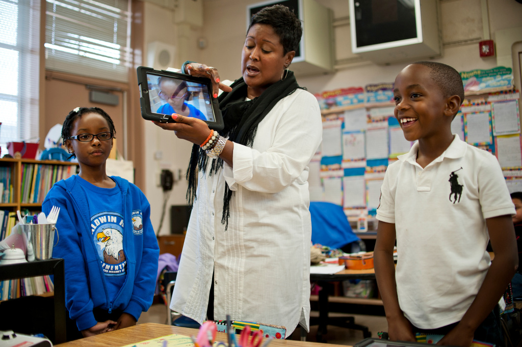 Second grade teacher Jacqueline Porter-Morris shows students how to take a picture for their iPad wallpaper for the first time on Friday, Nov. 15. Baldwin Hills is the final school to receive iPads as part of LAUSD's pilot program.