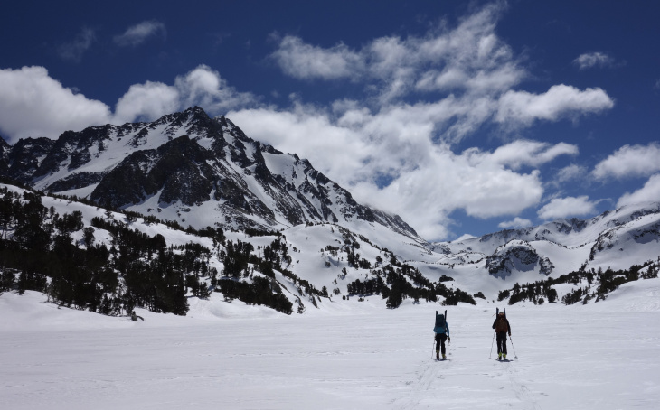 In this photo taken April 1, 2017, members of a California Cooperative Snow Survey team ski toward Bishop Pass in Inyo National Forest near Bishop, Calif. Despite new technologies, California's snowpack is still measured the old-fashioned way: by skiers who manually measure the depth and water content of the snowpack. The practice remains an important way to verify and fine-tune remotely collected data. (AP Photo/Brian Melley)