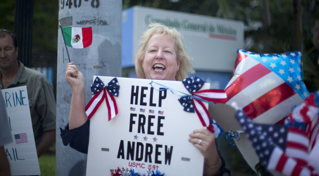 In this file photo, Jill Tahmooressi stands outside the Mexican Consulate in Miami, Monday, May 5, 2014, protesting the arrest of her son in Mexico. Andrew Tahmooressi, a Marine veteran who was arrested and jailed in Mexico on weapons charges for allegedly bringing guns across the border, says he never intended to leave the country but missed an exit when heading to meet friends in a border town. He told the newspaper that Mexican authorities found three guns inside the truck he had recently driven across the country to make a new start in San Diego.