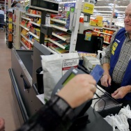 Clayton Fackler, 72, works at the check out at the new 2,000 square foot Wal-Mart Supercenter store May 17, 2006 in Bowling Green, Ohio.