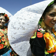 Two girls wearing Oaxacan traditional co