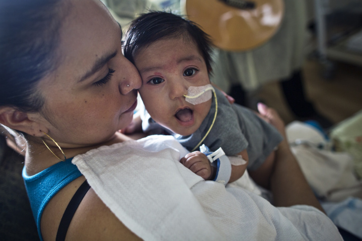 Araceli Viveros' 3-month-old son listens as music therapist Tacy Pillow plays a lullaby on Friday, Feb. 20, 2015 in the Newborn and Infant Critical Care Unit at Children's Hospital Los Angeles. The hospital uses music to help calm babies in the unit.