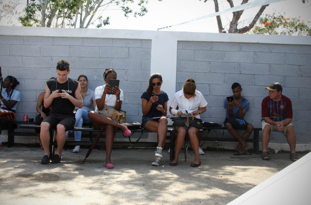 The Havana studio of prominent artist Kcho is ringed by Cubans with their heads buried in screens. Users say the only other free Internet connection in Havana is at the U.S. Interests Section.