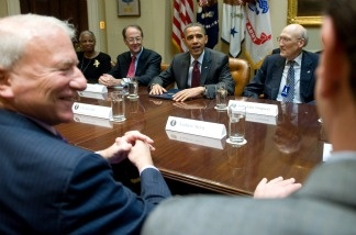 President Barack Obama speaks alongside members of the National Commission on Fiscal Responsibility and Reform prior to their meeting in the Roosevelt Room of the White House in Washington, DC in April.