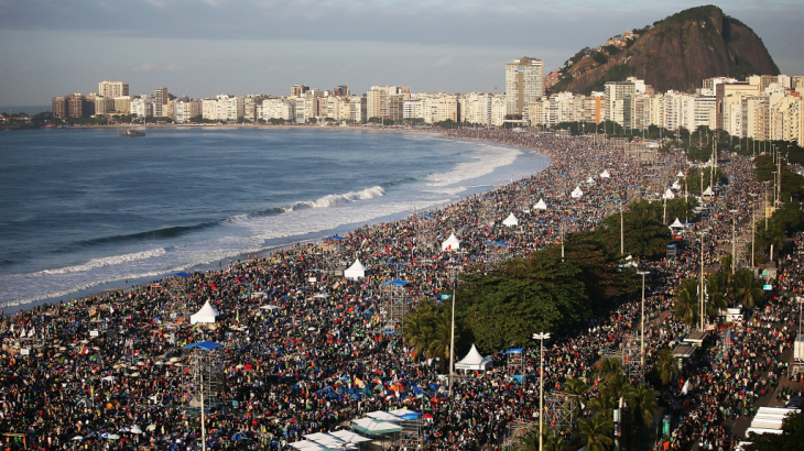 Pilgrims and residents gather on Copacabana Beach in Rio to await Pope Francis' final Mass on his trip to Brazil.