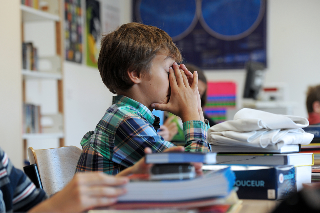 A pupil concentrates in a classroom at the Europeen school of Strasbourg, eastern France, on September 4, 2012, after the start of the new school year.