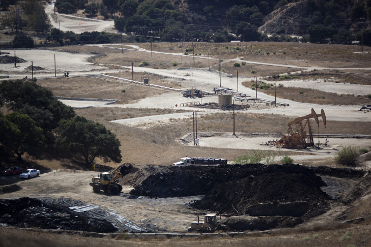 An oil well frames vineyards in Cat Canyon in Santa Barbara County. Measure P would ban some common practices used in oil fields, which would ultimately destroy the industry in Santa Barbara County, opponents say.