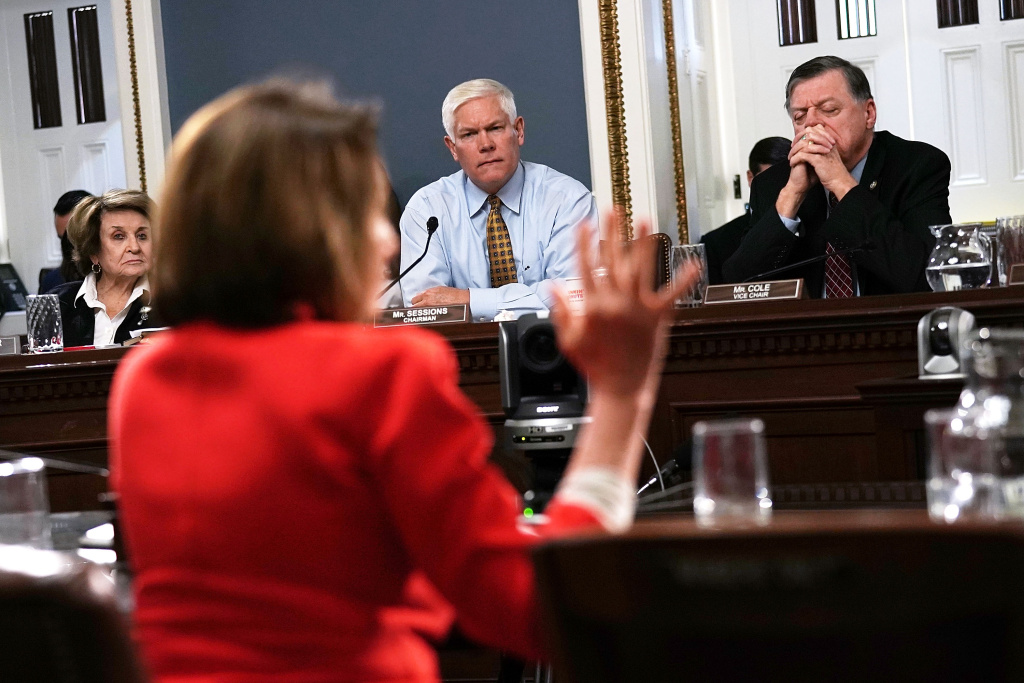 U.S. House Rules Committee Chairman Rep. Pete Sessions (R-TX) (C), Rep. Tom Cole (R-OK) (R) and Rep. Louise Slaughter (D-NY) (L) listen to House Minority Leader Rep. Nancy Pelosi (D-CA) during a meeting about a bill to avert government shutdown Dec. 21, 2017 at the Capitol in Washington, D.C.