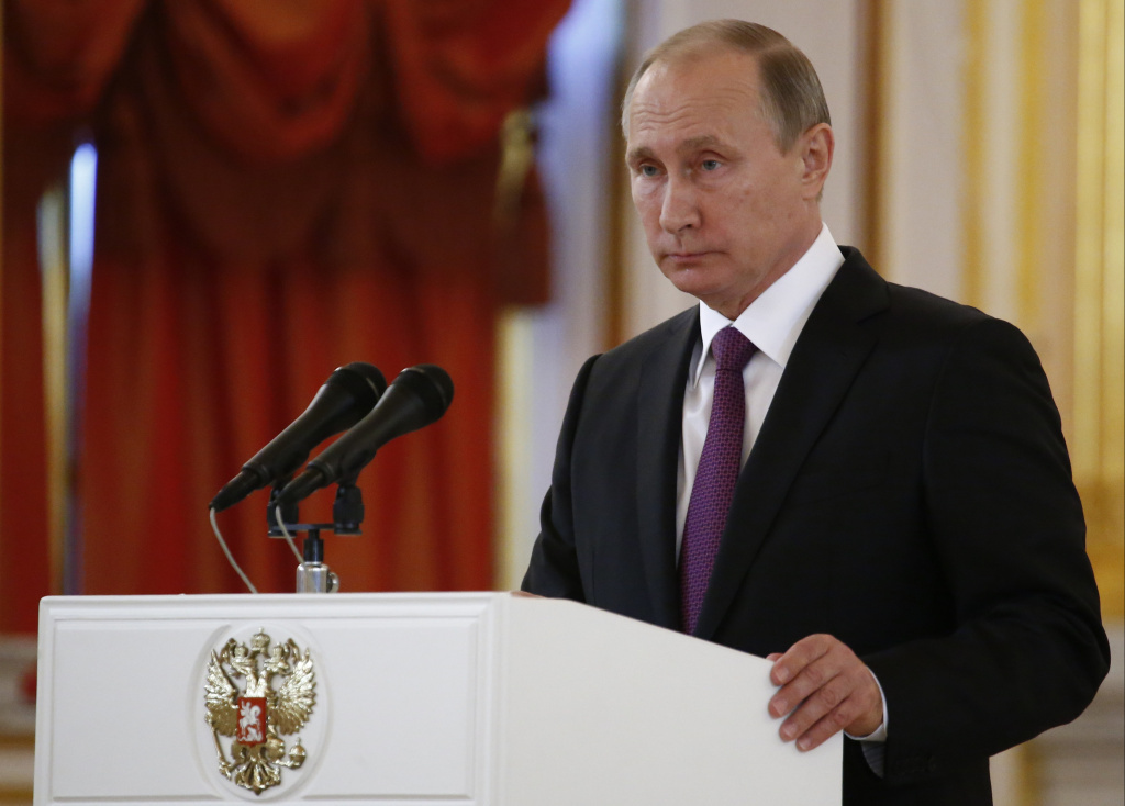Russian President Vladimir Putin speaks at the Kremlin in this file photo. The Democratic National Committee filed a lawsuit Friday alleging the Trump campaign, Russia and WikiLeaks conspired to help Trump win the 2016 presidential election.