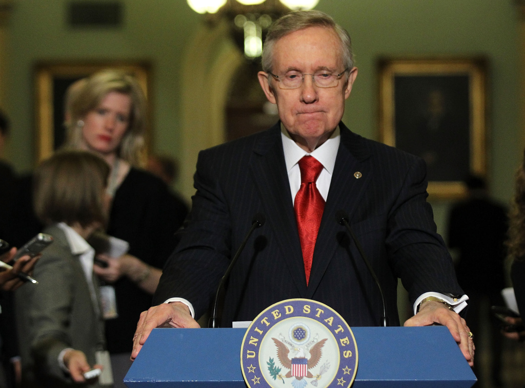 U.S. Senate Majority Leader Sen. Harry Reid (D-NV) speaks to members of the media during a news briefing after the weekly Democratic policy luncheon in December 2011. This week, Reid has threatened a bill to drastically alter filibuster rules, but the Senate appears to have reached a compromise.