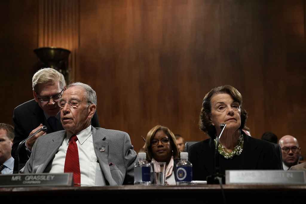 Committee Chairman U.S. Sen. Chuck Grassley (R-IA) (L) and ranking member Sen. Dianne Feinstein (D-CA) (R) participate in a markup hearing before the Senate Judiciary Committee September 13, 2018 on Capitol Hill in Washington, DC.