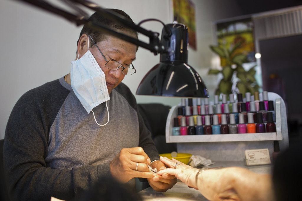 Chau Nguyen, co-owner of Nancy's Nails in Santa Monica, paints a customer's nails on Wednesday morning, March 5. Nancy's Nails is one of four nail salons in Santa Monica participating in the Healthy Nail Salon Recognition Program.