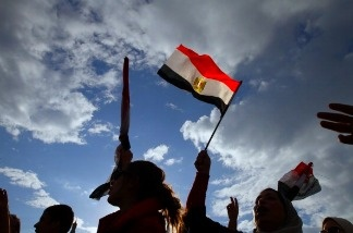 Egyptian anti-government demonstrators wave their national flag as they gather at Cairo's Tahrir Square on February 10, 2011 on the 17th day of consecutive protests calling for the ouster of President Hosni Mubarak.
