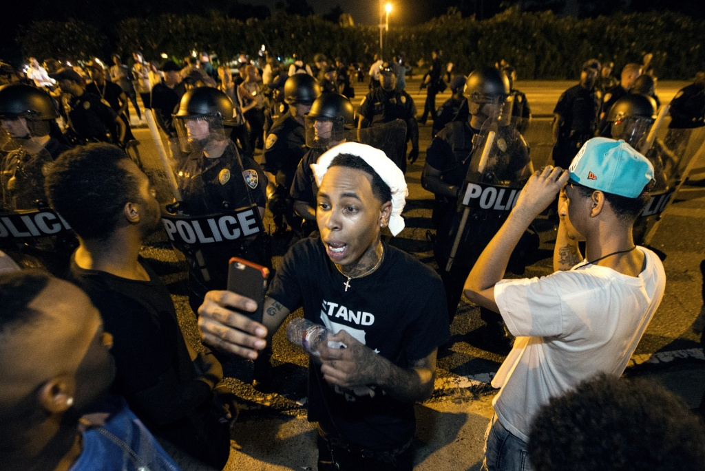 One of the protesters streams live video as they face off with Baton Rouge police July 8, 2016 in Baton Rouge, Louisiana. Alton Sterling was shot by a police officer in front of the Triple S Food Mart in Baton Rouge on July 5th, leading the Department of Justice to open a civil rights investigation.