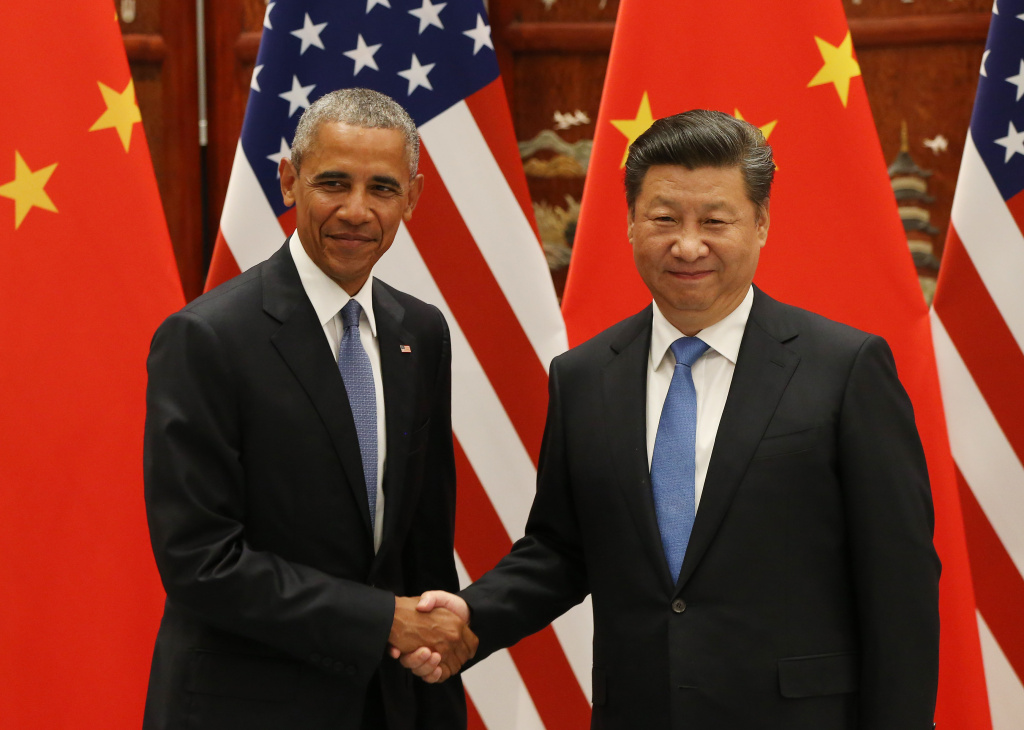 US President Barack Obama (L) and Chinese President Xi Jinping shake hands during their meeting at the West Lake State Guest House in Hangzhou on September 3, 2016. The United States and China on September 3 formally joined the Paris climate deal, with US President Barack Obama hailing the accord as the