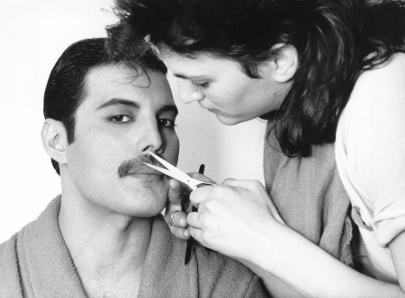 File: Queen's Freddie Mercury has his mustache groomed.