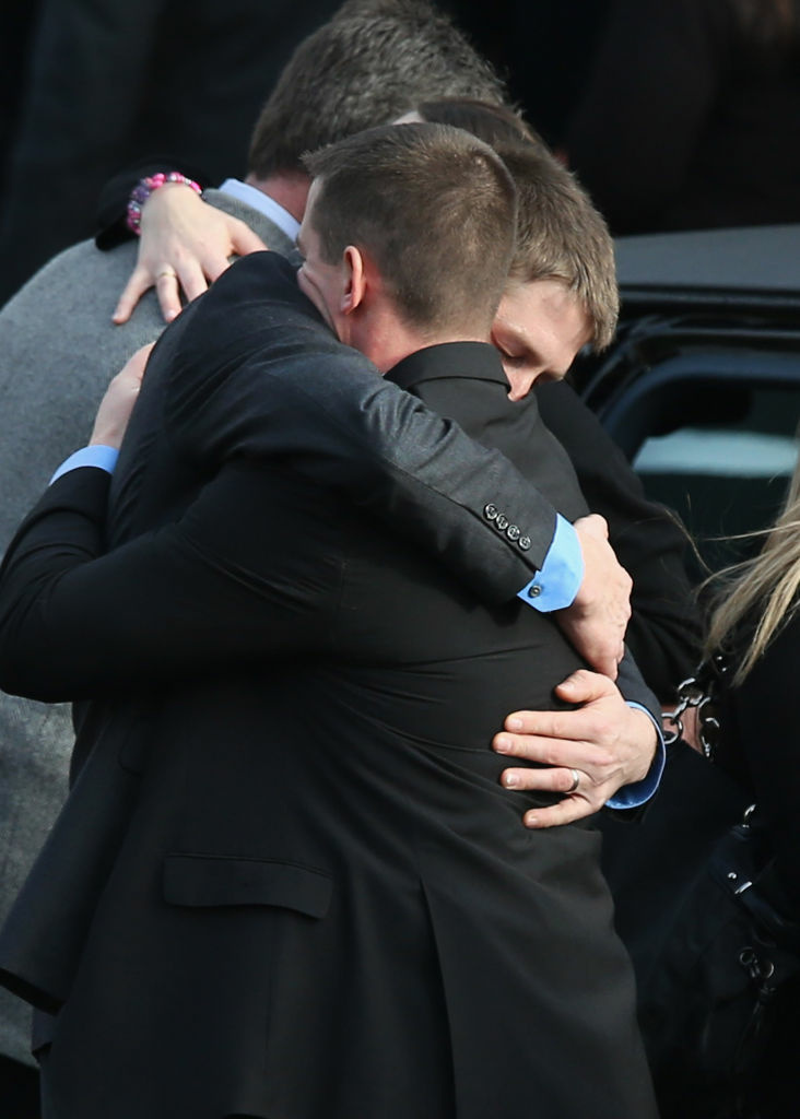 Family and friends embrace after the funeral for shooting victim Jessica Rekos, 6, at the St. Rose of Lima Catholic church on Tuesday in Newtown, Connecticut. Funeral services continue on Wednesday.