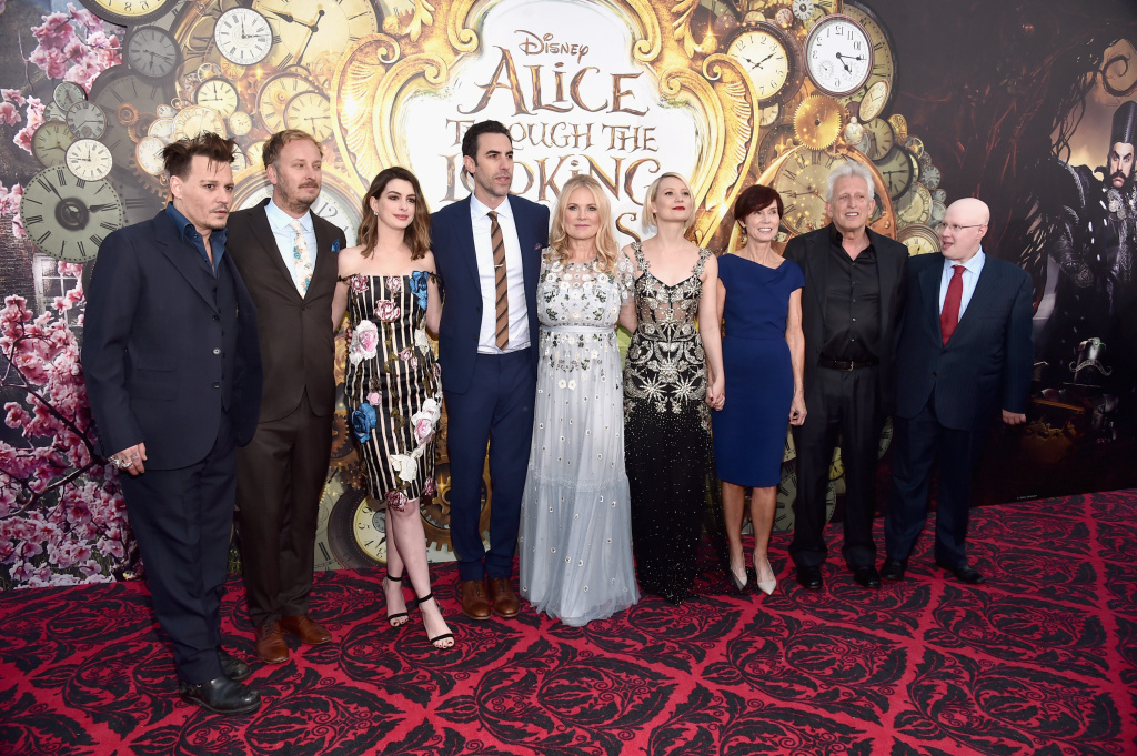 (L-R) Actor Johnny Depp, director James Bobin, actors Anne Hathaway, Sacha Baron Cohen, producer Suzanne Todd, Mia Wasikowska, screenwriter Linda Wollverton, producer Joe Roth and actor Matt Lucas attend Disney's 'Alice Through the Looking Glass' premiere in Hollywood, California.