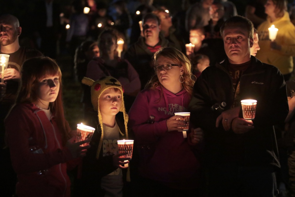 Denizens of Roseburg gather at a candlelight vigil for the victims of a shooting October 1, 2015 in Roseburg, Oregon. According to reports, 10 were killed and 20 injured when a gunman opened fire at Umpqua Community College in Roseburg, Oregon.