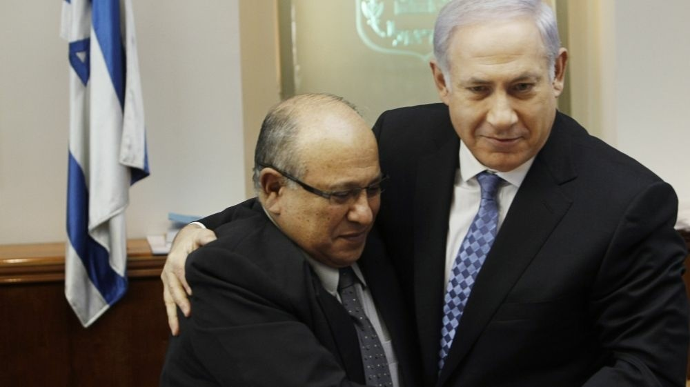 Israeli Prime Minister Benjamin Netanyahu embraces Meir Dagan, the then-outgoing chief of the Mossad intelligence agency, in January 2011.