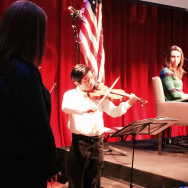 Daniel Gomez of the Boyle Heights Community Youth Orchestra plays for the audience at a Crawford Family Forum event Sunday on music and the brain.