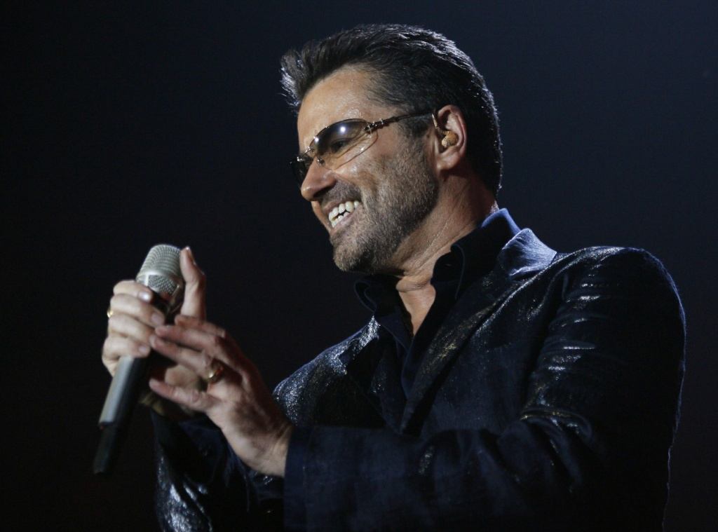 British singer George Michael performs during his concert at the Hallenstadion arena in Zurich, Switzerland, on Thursday evening, Oct. 26, 2006.