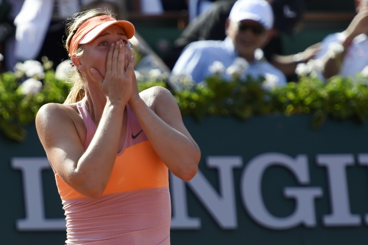 Maria Sharapova of Russia celebrates match point during her women's singles final match against Simona Halep of Romania on day fourteen of the French Open at Roland Garros on June 7, 2014 in Paris, France.