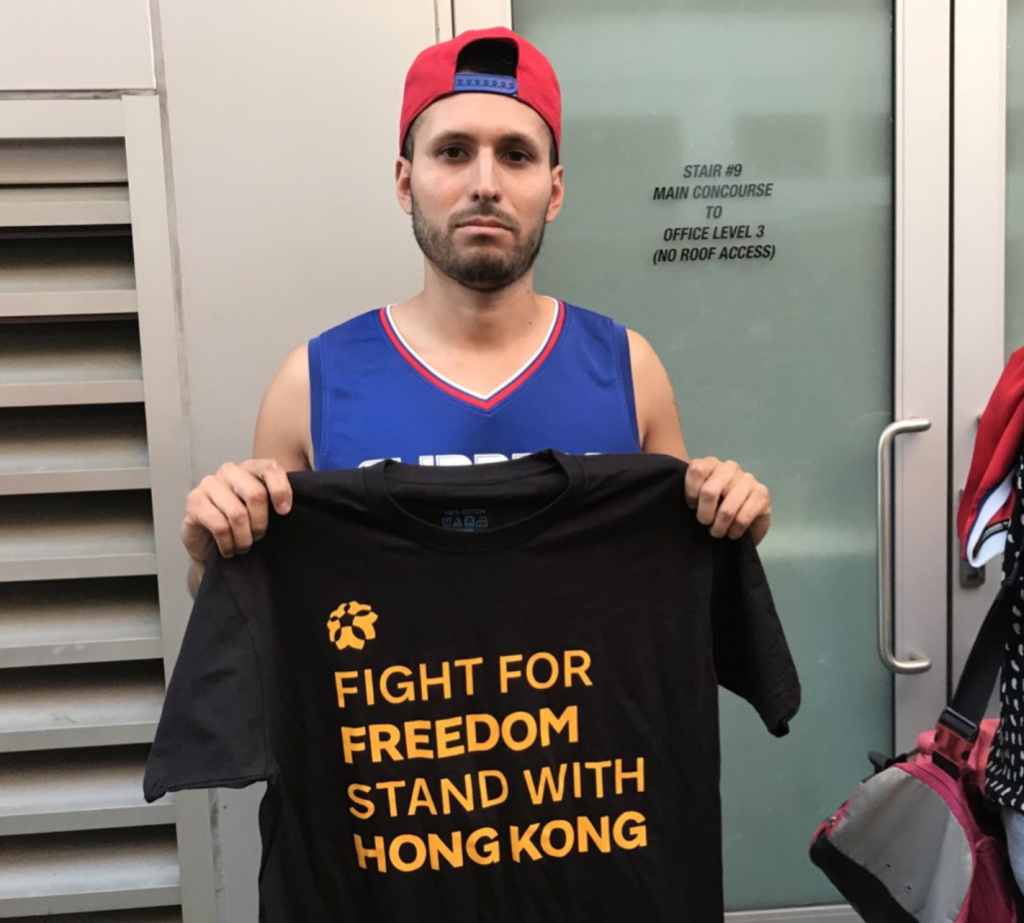 L.A. Clippers fan Ernesto Becerra of Upland said he would put on the shirt inside Staples to show support for Hong Kong protesters.