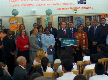 California Governor Arnold Schwarzenegger talks on Thursday, Jan. 7, 2010 to eighth graders during the signing of education reform measure 'Race to the Top' at Mary McLeod Bethune Middle School in South Los Angeles.