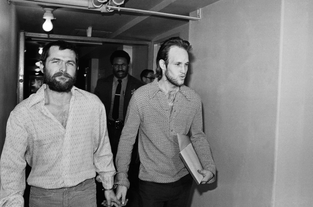 This Dec. 22, 1970 file photo shows two members of the Charles Manson family, Bruce Davis, left, and Steve Grogan, leaving court after a hearing on the appointment of attorneys to represent them in Los Angeles.