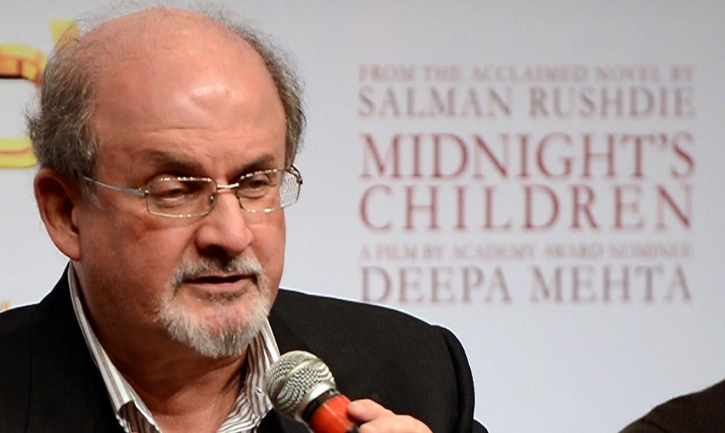 "Indian born British author Salman Rushdie looks on at a function to promote the film 'Midnight's Children' in Mumbai on January 29, 2013, just prior to its release in India on February 1. Directed by Deepa Mehta, the film is based on Rushdie's Booker Prize-winning novel 'Midnight's Children',"" which he also adapted for the screen."