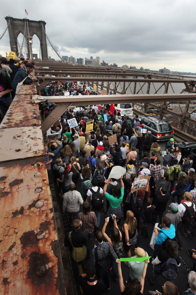 Demonstrators affiliated with the Occupy Wall Street movement attempt to cross the Brooklyn Bridge on the motorway on October 1, 2011 in New York City. The motorway portion of the bridge is not intended for pedestrians and as the marchers attempted to cross, they were stopped midway by police. Hundreds of protesters were arrested.