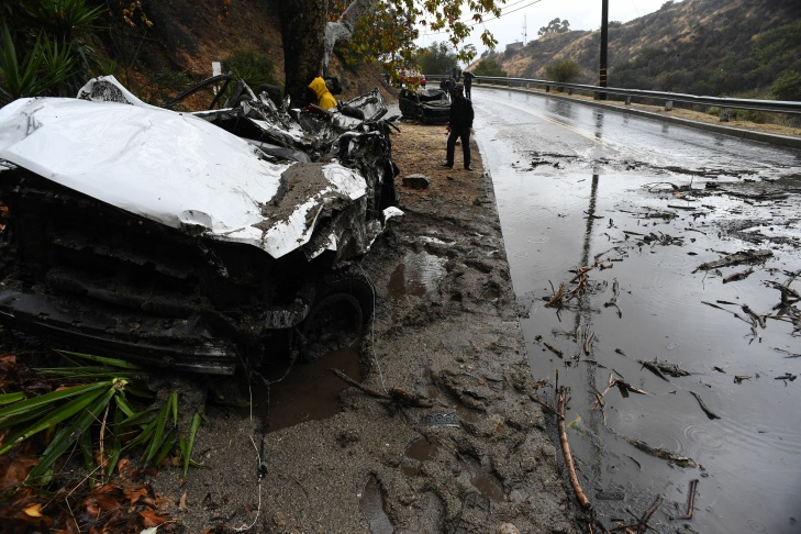 Mud fills a street after a rain-driven mudslide destroyed two cars and damaged property in a neighborhood under mandatory evacuation in Burbank, California, Jan. 9, 2018.
