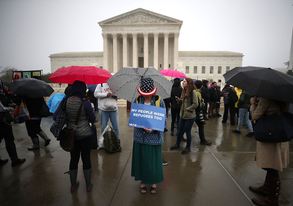 People gather to protest President Trump's travel ban in front of the U.S. Supreme Court, on April 25, 2018 in Washington, DC.