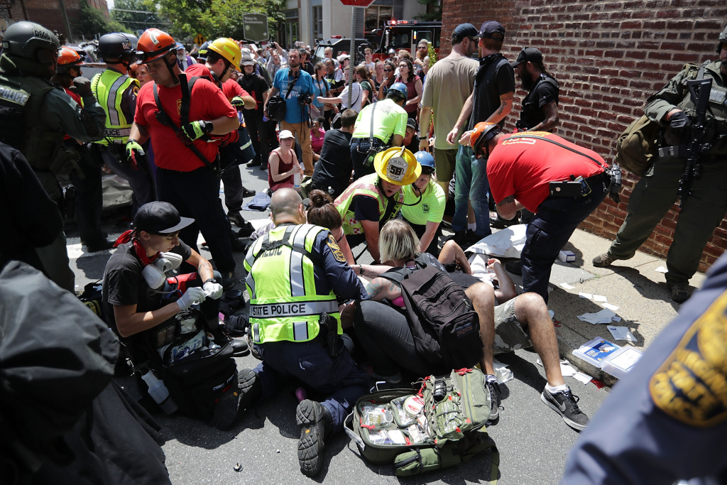 Rescue workers and medics tend to people who were injured when a car plowed through a crowd of anti-fascist counter-demonstrators marching on August 12, 2017 in Charlottesville, Virginia.