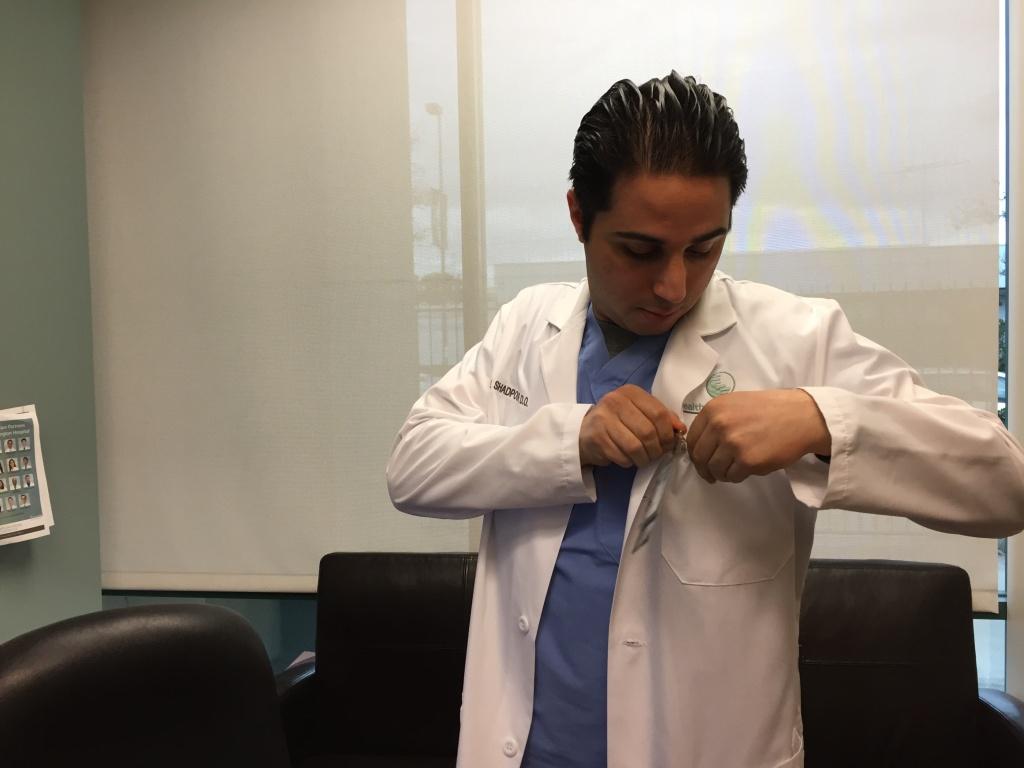 Dr. Joseph Shadpour prepares to evaluate patients in urgent care with flu symptoms.