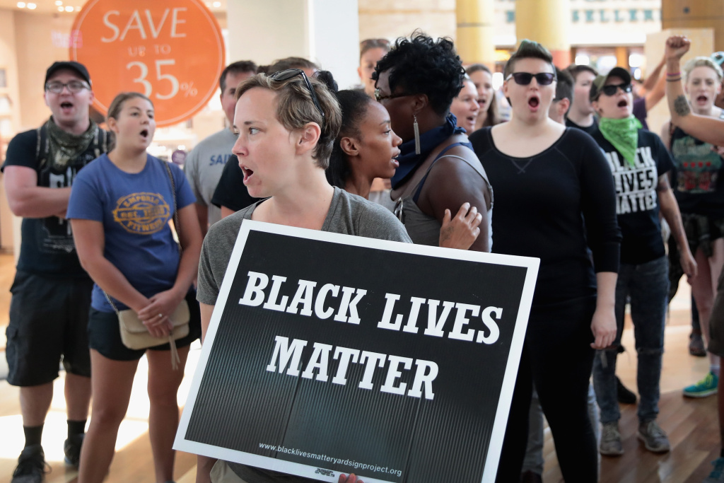 ST LOUIS, MO - SEPTEMBER 16:  Demonstrators march through the West County Mall protesting the acquittal of former St. Louis police officer Jason Stockley on September 16, 2017 in St. Louis, Missouri. The St. Louis area is bracing for a second day of protests following yesterday's acquittal of Stockley, who was charged with first-degree murder last year following the 2011 shooting of Anthony Lamar Smith.  (Photo by Scott Olson/Getty Images)