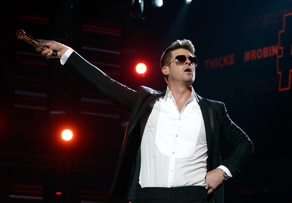 Singer Robin Thicke performs onstage during the 2013 BET Awards at Nokia Theatre L.A. Live on June 30, 2013 in Los Angeles, California.