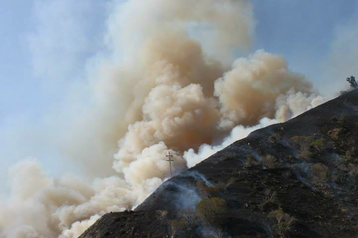 A fire that broke out Tuesday close to the I-5 near Lebec in Kern County threatened about 45 homes and other buildings.