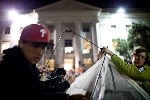 University of California, Berkeley students set up tents after a general assembly voted to again occupy campus as part of an 'open university' strike in solidarity with the Occupy Wall Street movement on November 15, 2011 in Berkeley, California. Teach-outs, workshops, public readings, and marches will culminate in an attempt to re-establish an Occupy Cal encampment that was shut down by police last week.