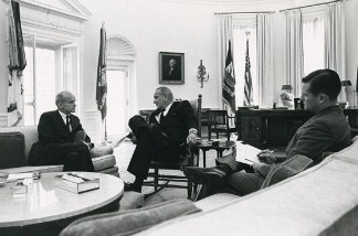 Wisconsin Sen. William Proxmire (left) meeting with President Lyndon B. Johnson (center) in the Oval Office. The third person is unidentified.