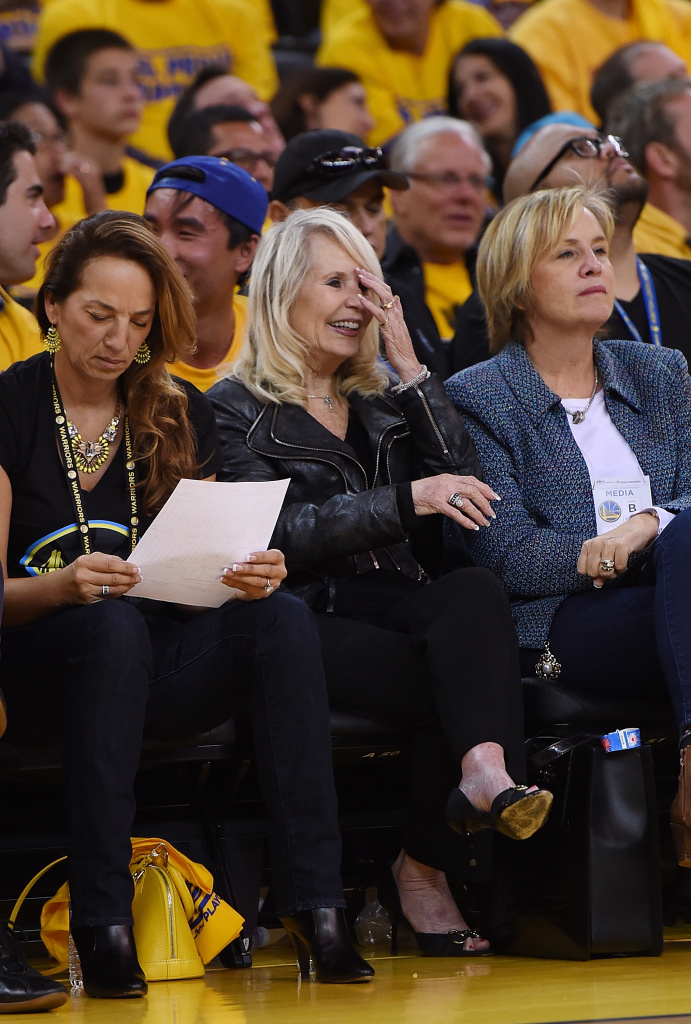 OAKLAND, CA - APRIL 27:  Shelly Sterling (C), the wife of Donald Sterling owner of the Los Angeles Clippers, watches the Clippers against the Golden State Warriors in Game Four of the Western Conference Quarterfinals during the 2014 NBA Playoffs at ORACLE Arena on April 27, 2014 in Oakland, California. The players wore theirs warm up this way in protest of owner Donald Sterling's racially insensitive remarks.