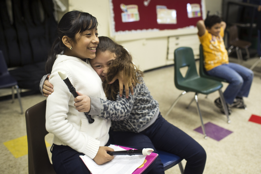 Fourth-graders Jennifer Moncada, left, and Josephine Moreno are students at Martin Luther King Jr. Elementary School in Compton — a Turnaround Arts school. The federally backed program will expand arts education resources to pre-K and early education in the fall.