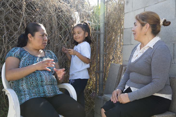 Rocio Alfaro (left), Wendy Mendez (middle) and Mery Alvarez (right) attend a lunch on Feb. 10, 2016 in Watts where the topic of conversation was the upcoming 2016 elections.